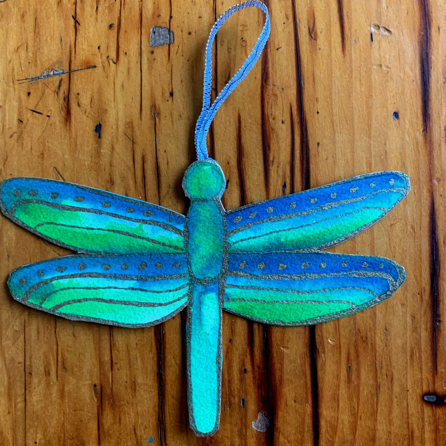 Dragonflies are one of the paper crafts I make at the table. Here's the link to  see more of my artworks.