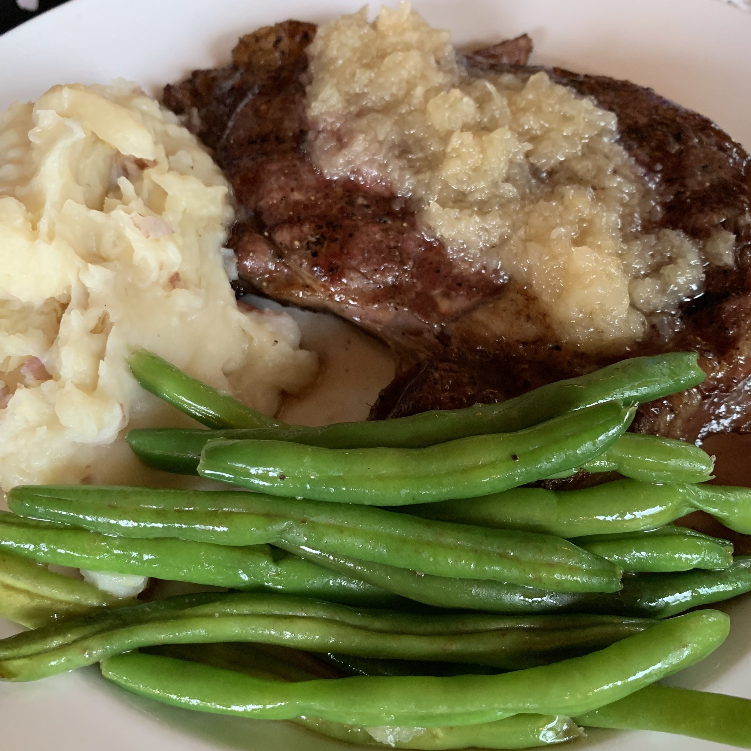 Steak Special with shallots, green beans and rustic mashed potatoes.