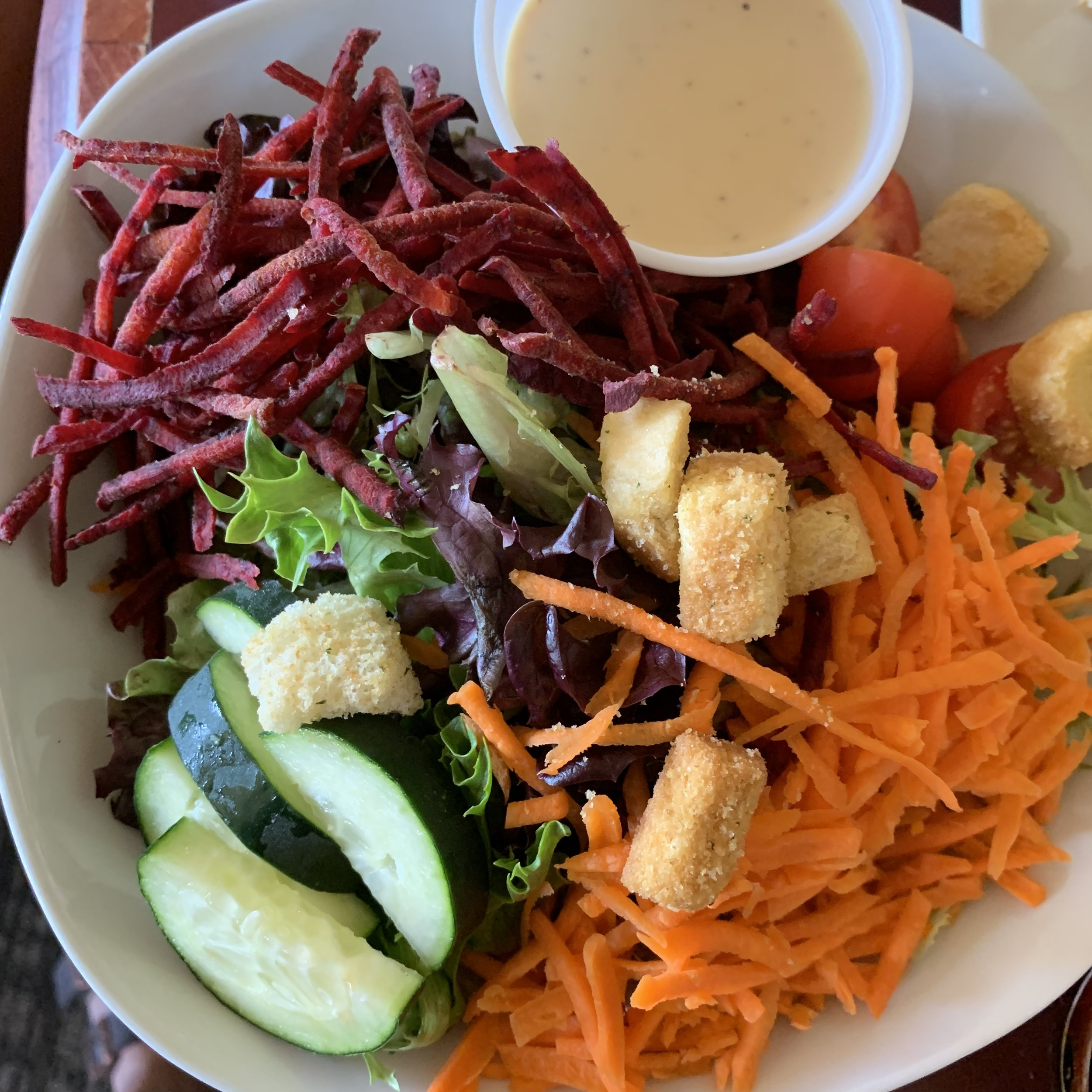 House salad with grated carrots and raw beets. I had the honey mustard dressing.