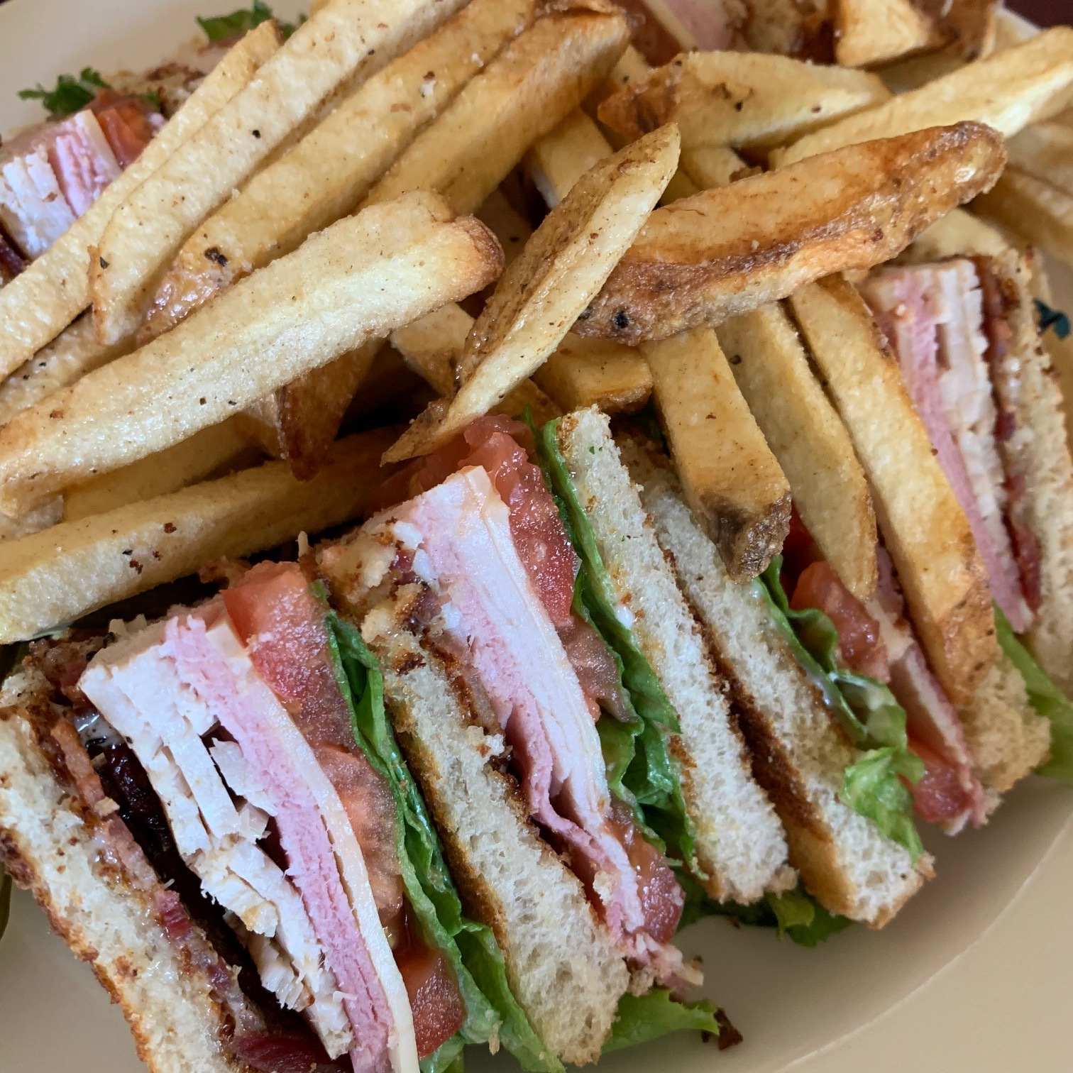 The Club Sandwich with plenty of crispy salty french fries. It's big enough to share.