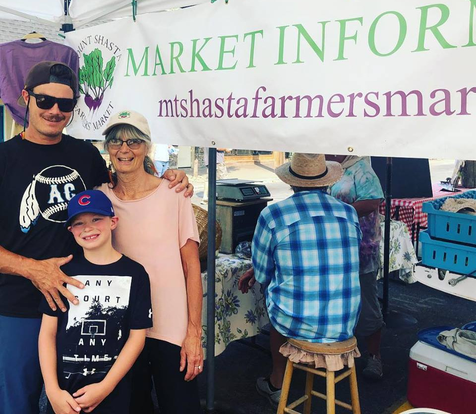 Paj and her son, Brennan Kand and grandson Caden at the Mount Shasta Famer's Market
