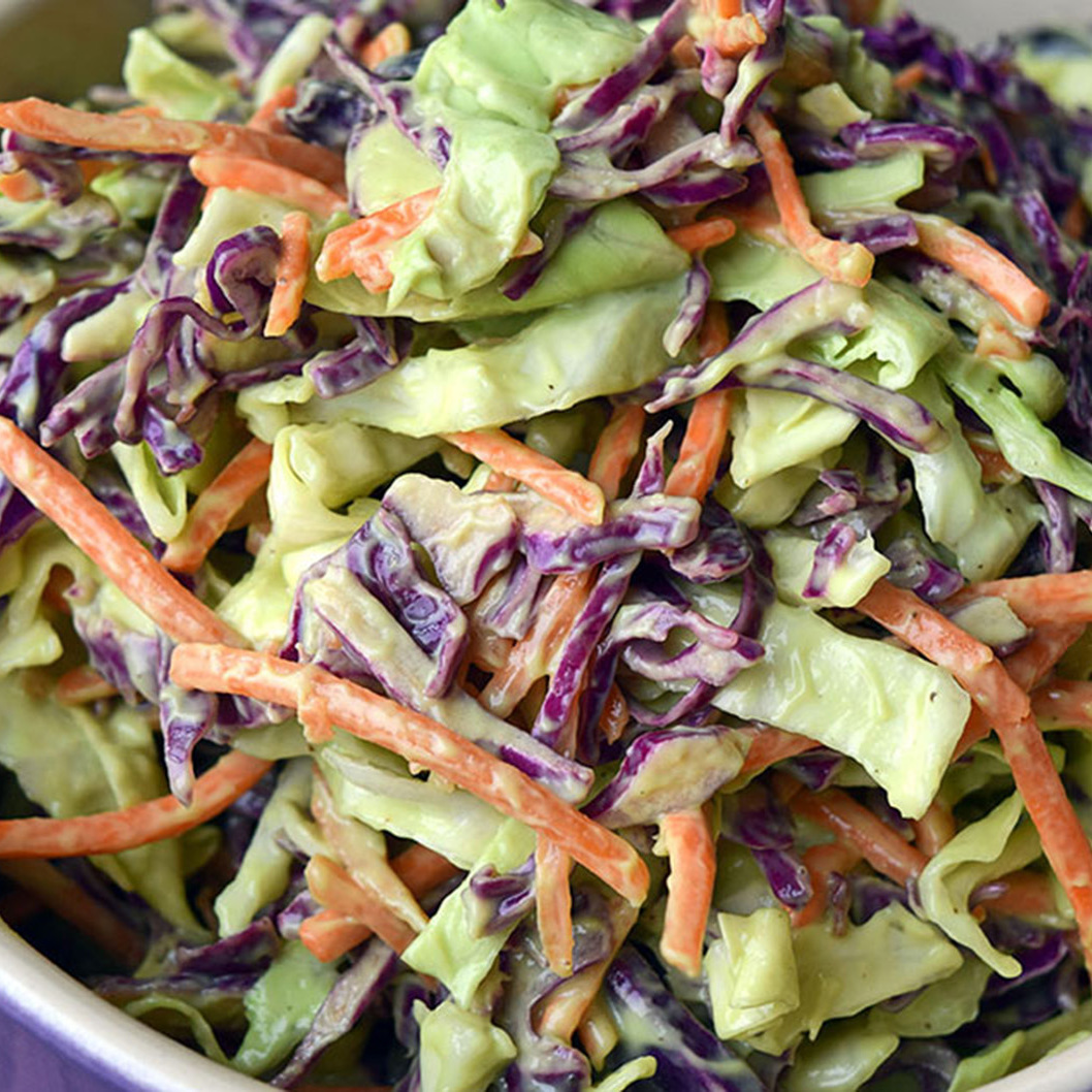 Creamy and colorful vegan coleslaw made with avocado