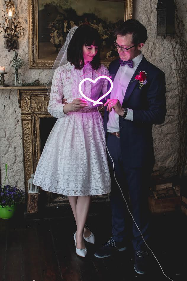1970's cool! - Our stunning bride Aoife wore the prettiest, lace, knee length wedding dress from the 1970's for her wedding. She chose one of our full underskirts to add a fun, vintage feel.Aoife added a belt and adorable veil to complete her look.Congratulations to Aoife and her new hubby on their recent wedding!