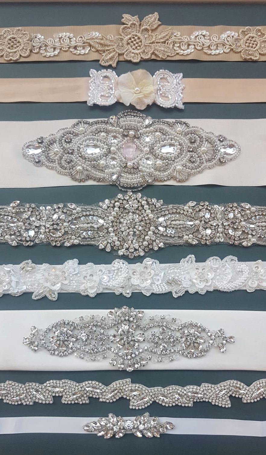 Sashes   What better way of adding a touch of sparkle or colour than by adding a sash. It will define your waist and add extra interest to your dress. Our collection of new and bespoke sashes offer so much choice. We'll help you pick the best style to suit your dress, whether it's simple, fun, elaborate or chic. If we don't have what you're looking for, we can create one just for you. A fabulous option if you are looking to work in your bridal party colours!
