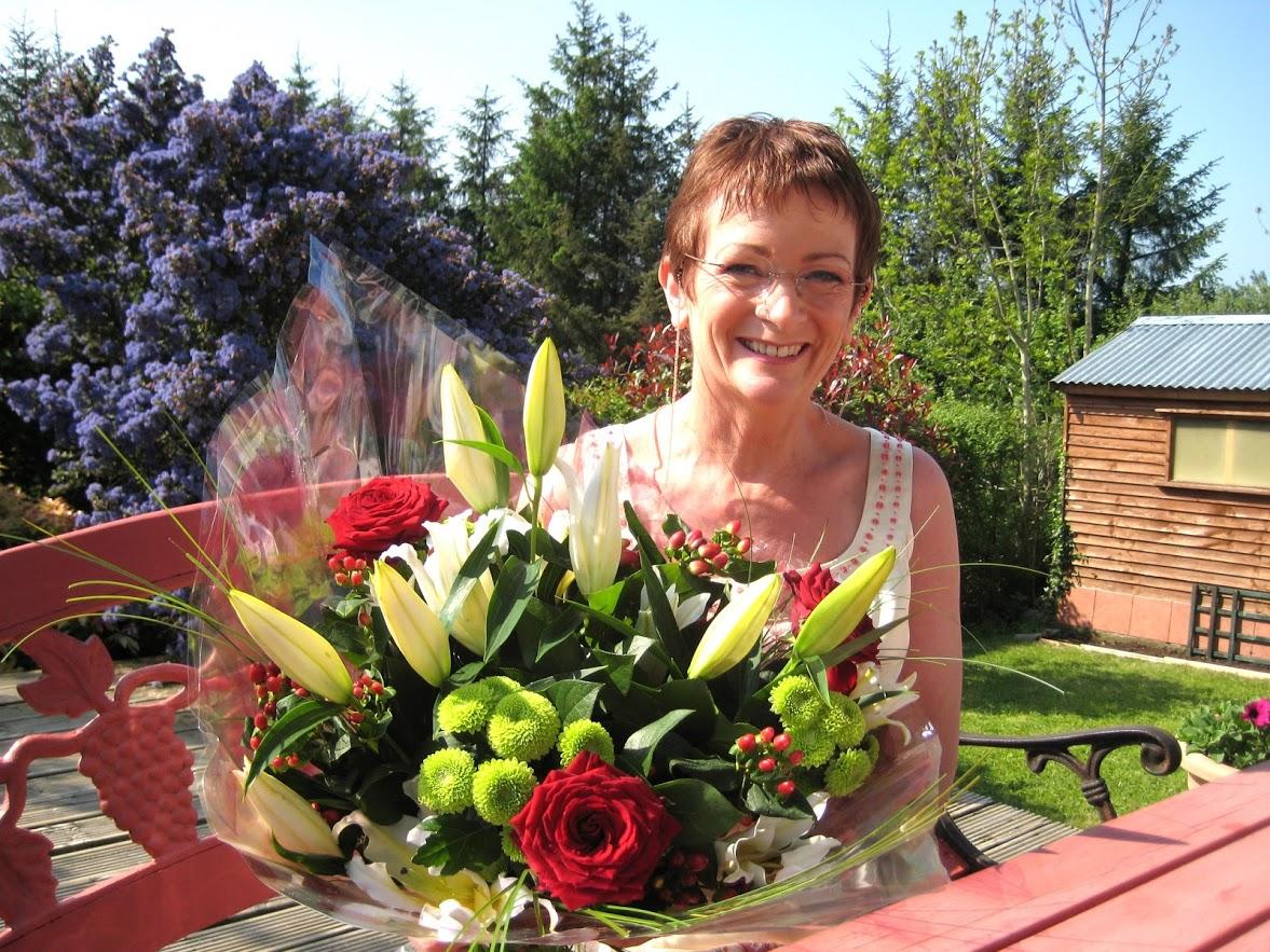 mum with flowers.JPG
