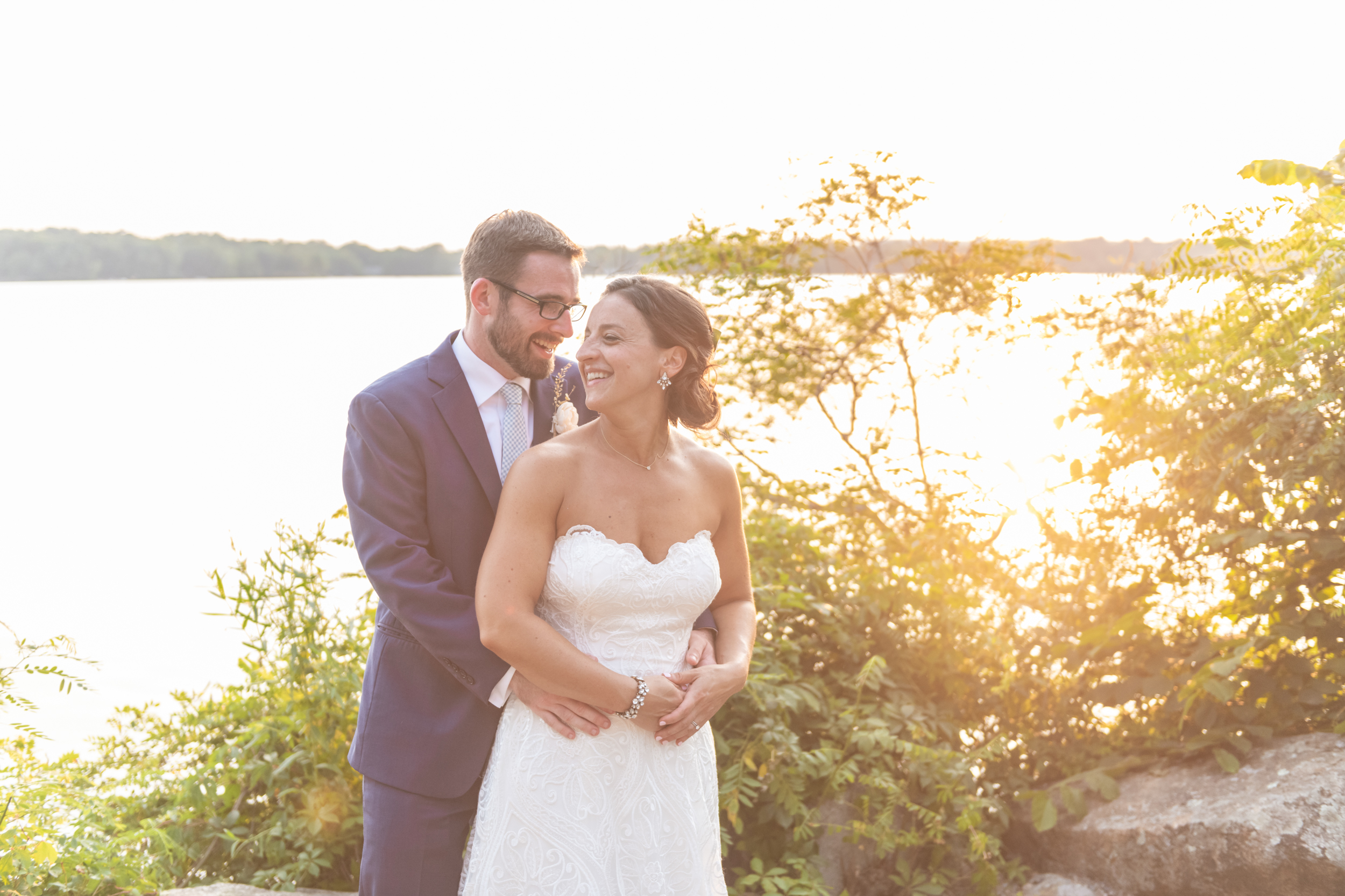 """- """"Mary was easy to work with from our first meeting to the engagement session, through the wedding night. She was professional and kind, and made us feel comfortable taking photos that can sometimes feel awkward! She captured the essence of our ceremony and reception in all of their photos and we couldn't be happier with the photos.""""- Katie & Phil -"""