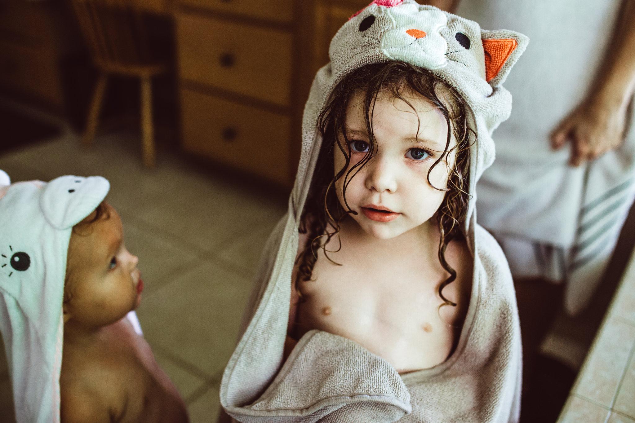 Little girls wear animal bathtub hoods after bath