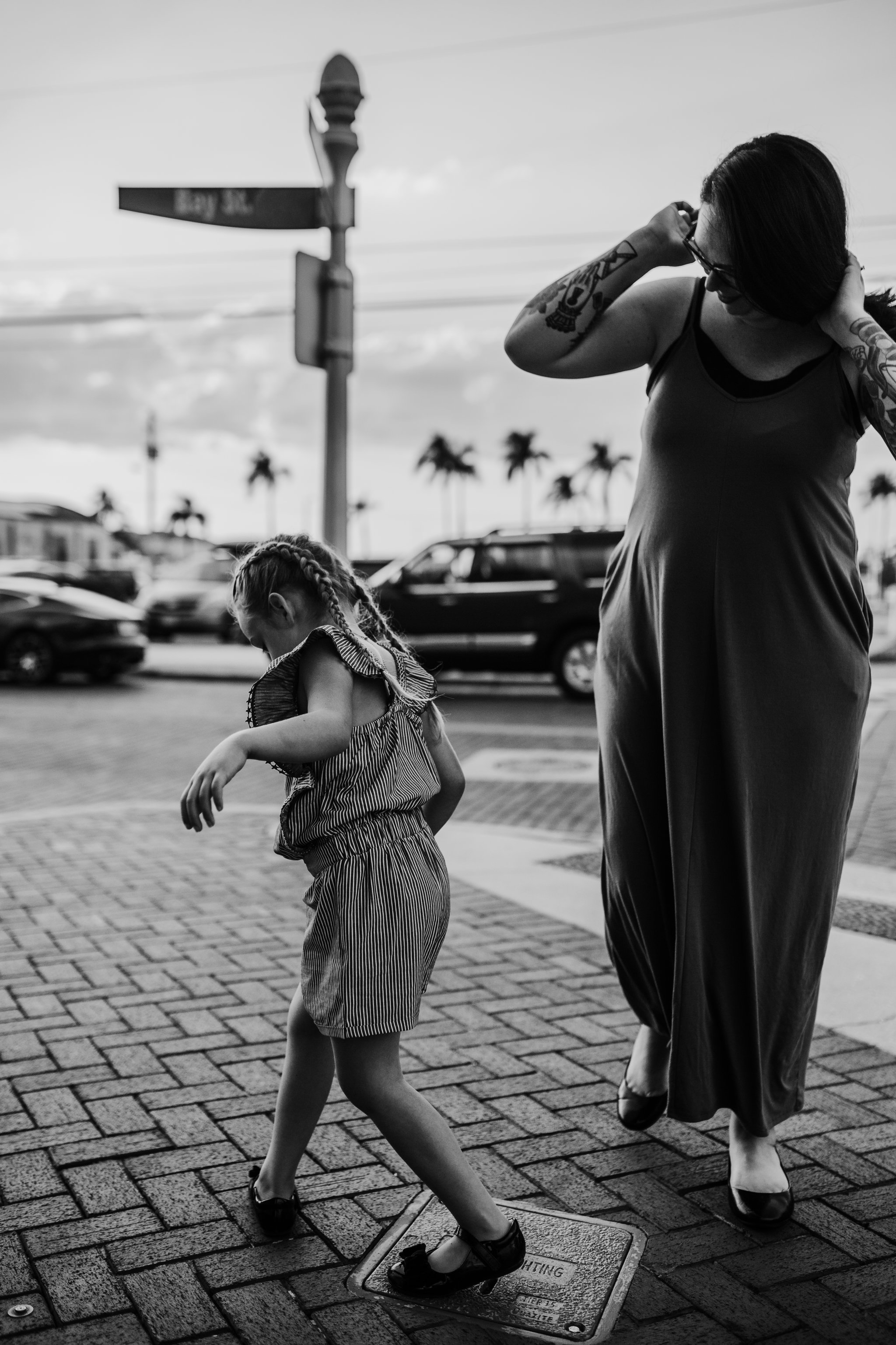 Mother and daughter play on Bay street in Fort Myers