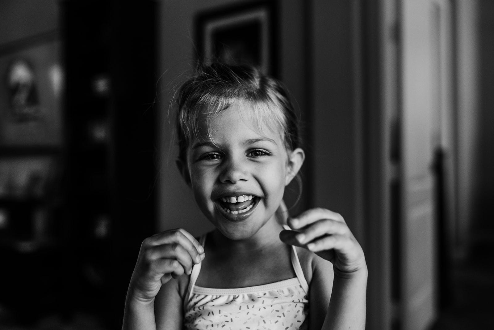 little girl smiling big