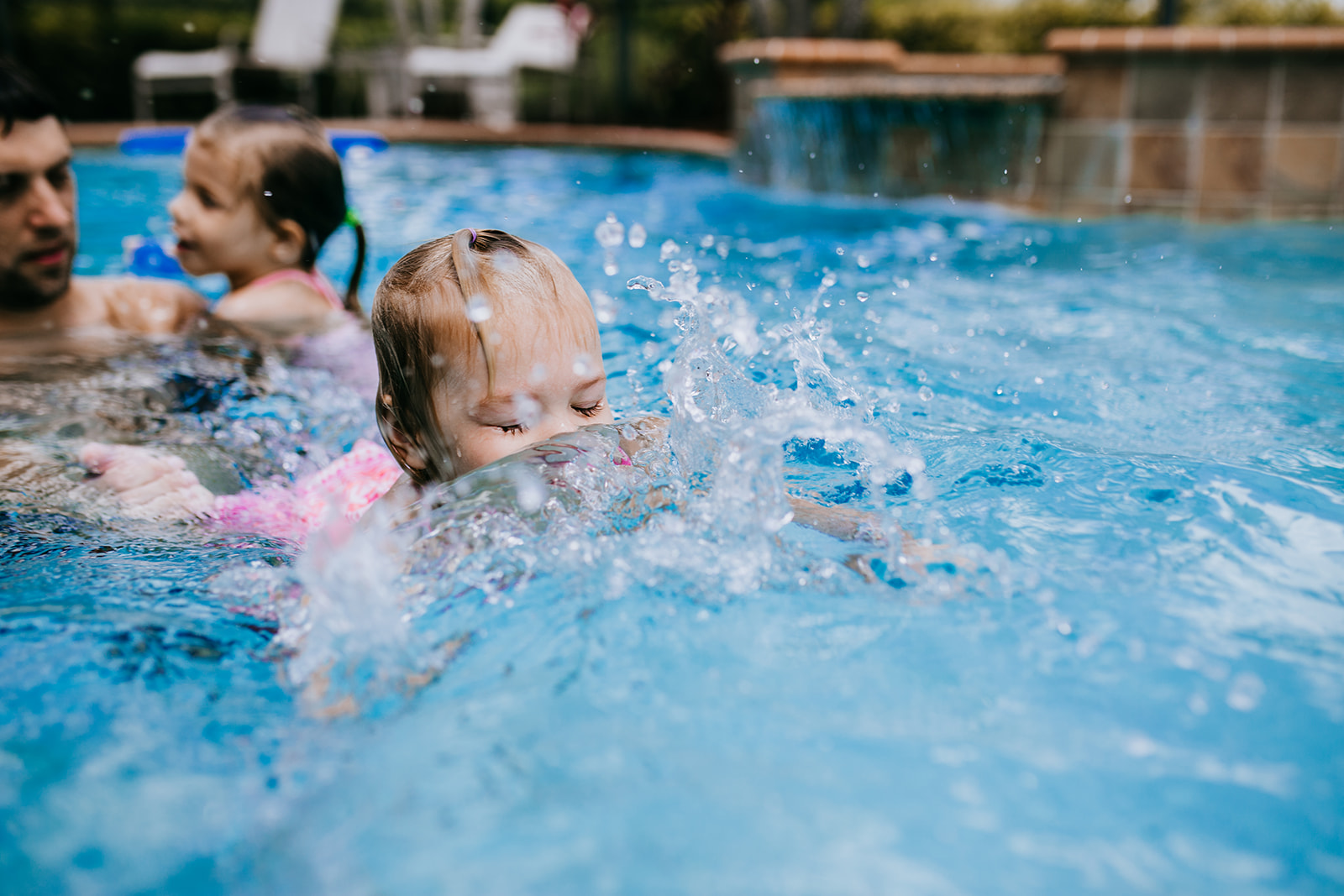 Toddler swims in south florida pool