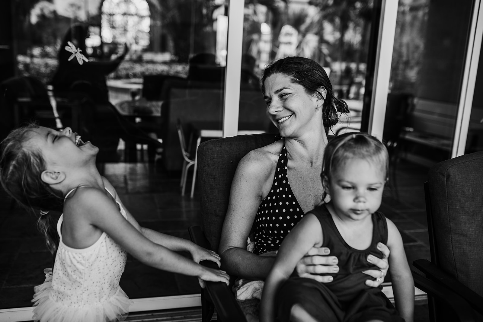 Mom and two girls laughing