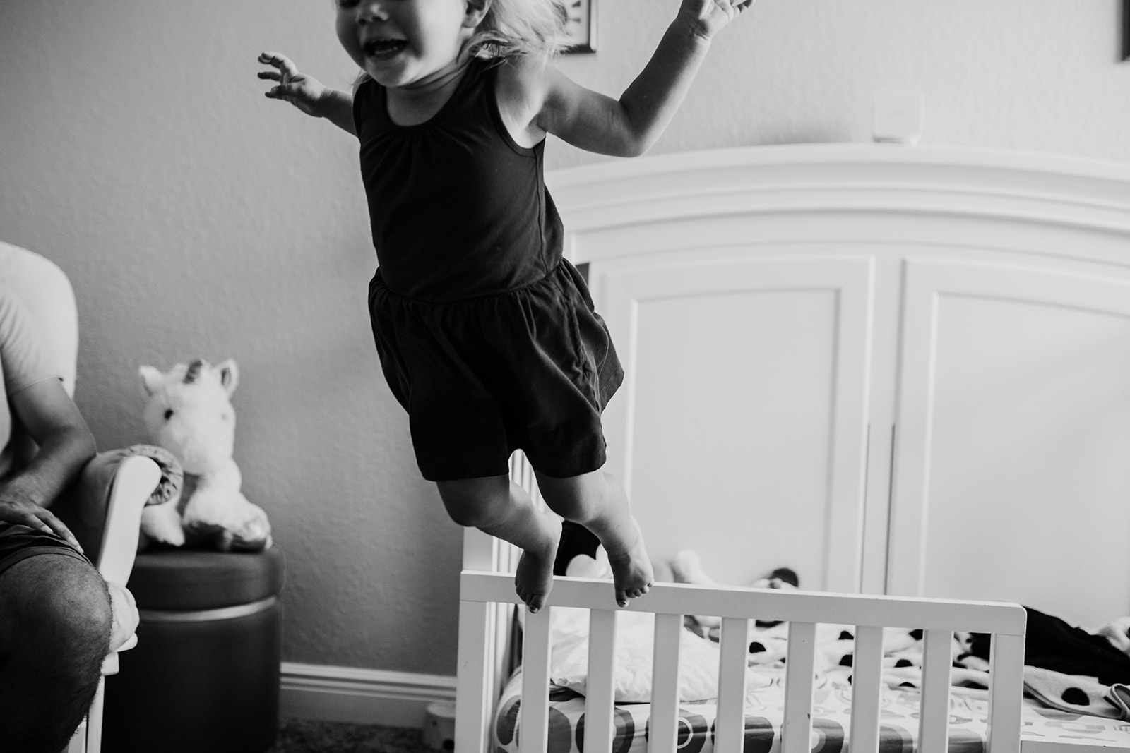 Toddler jumps off of her crib