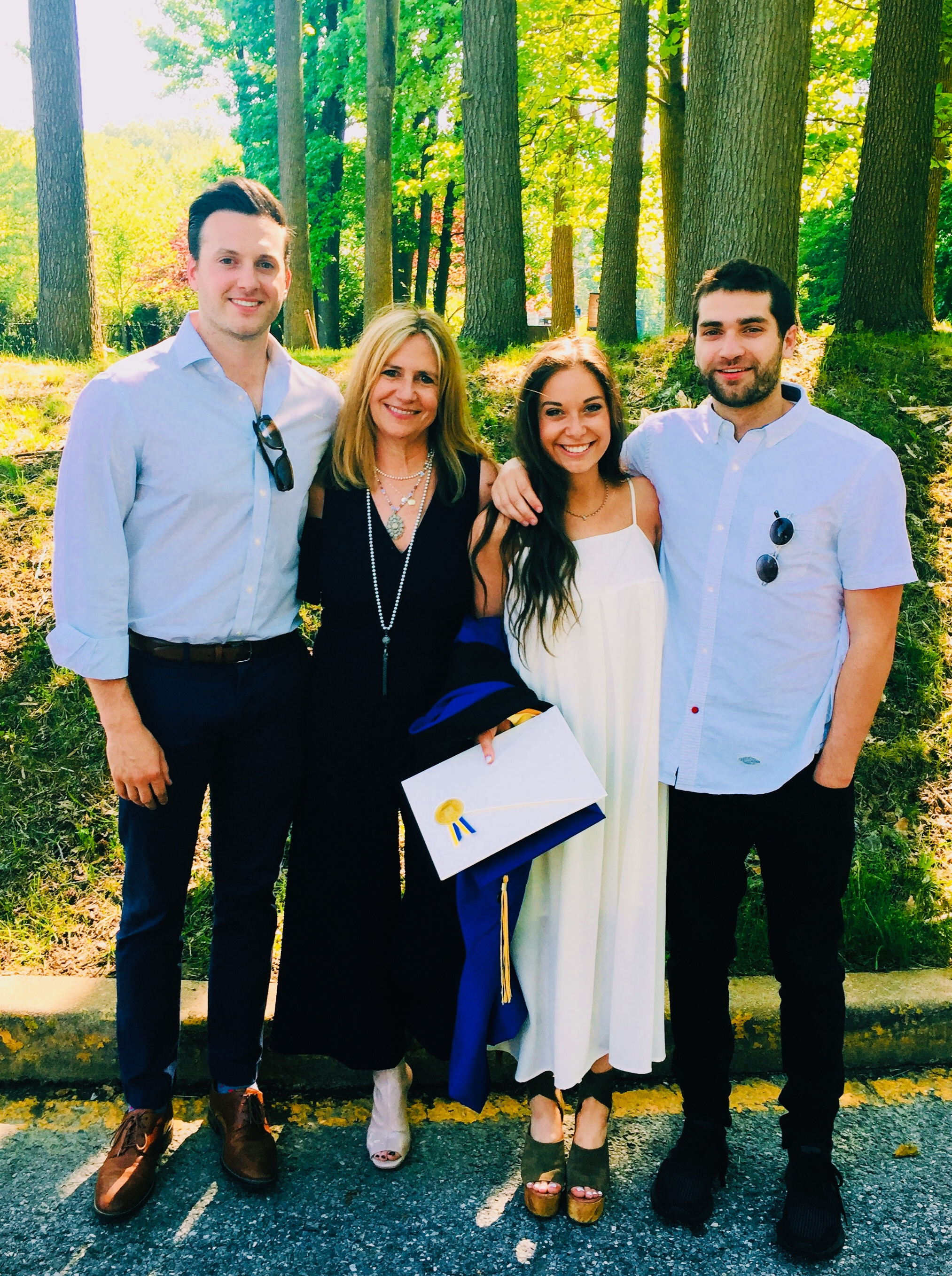 Cindy and her three STMS alumni: Nicholas Calitri '06; Samantha Calitri '10; Tyler Calitri '08