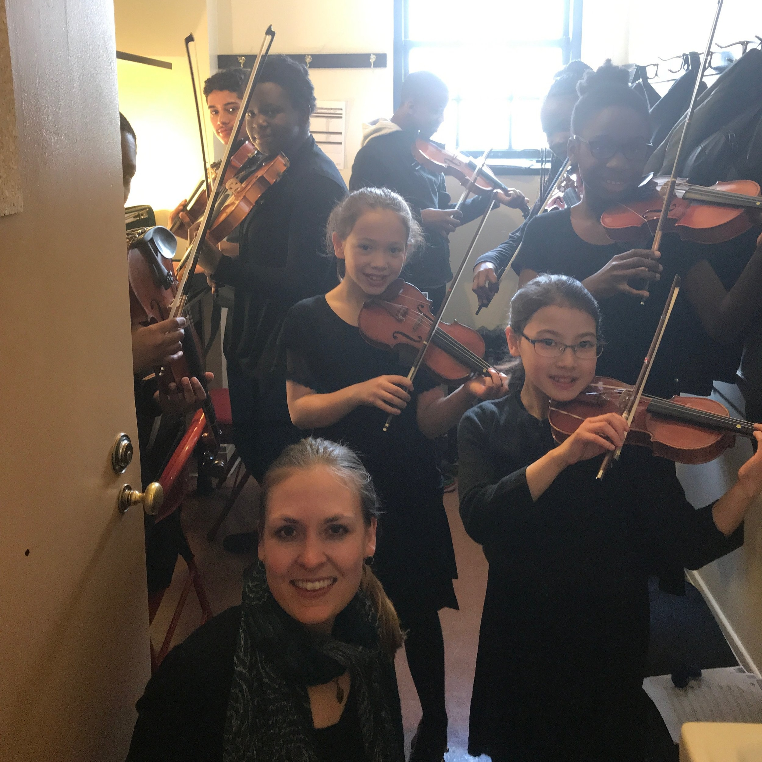 Ms. Leffingwell with some of her former STA students and other young musicians from the Greater Hartford Area in the backstage area just before performing at the Bushnell Performing Arts Center with the Hartford Symphony Orchestra.