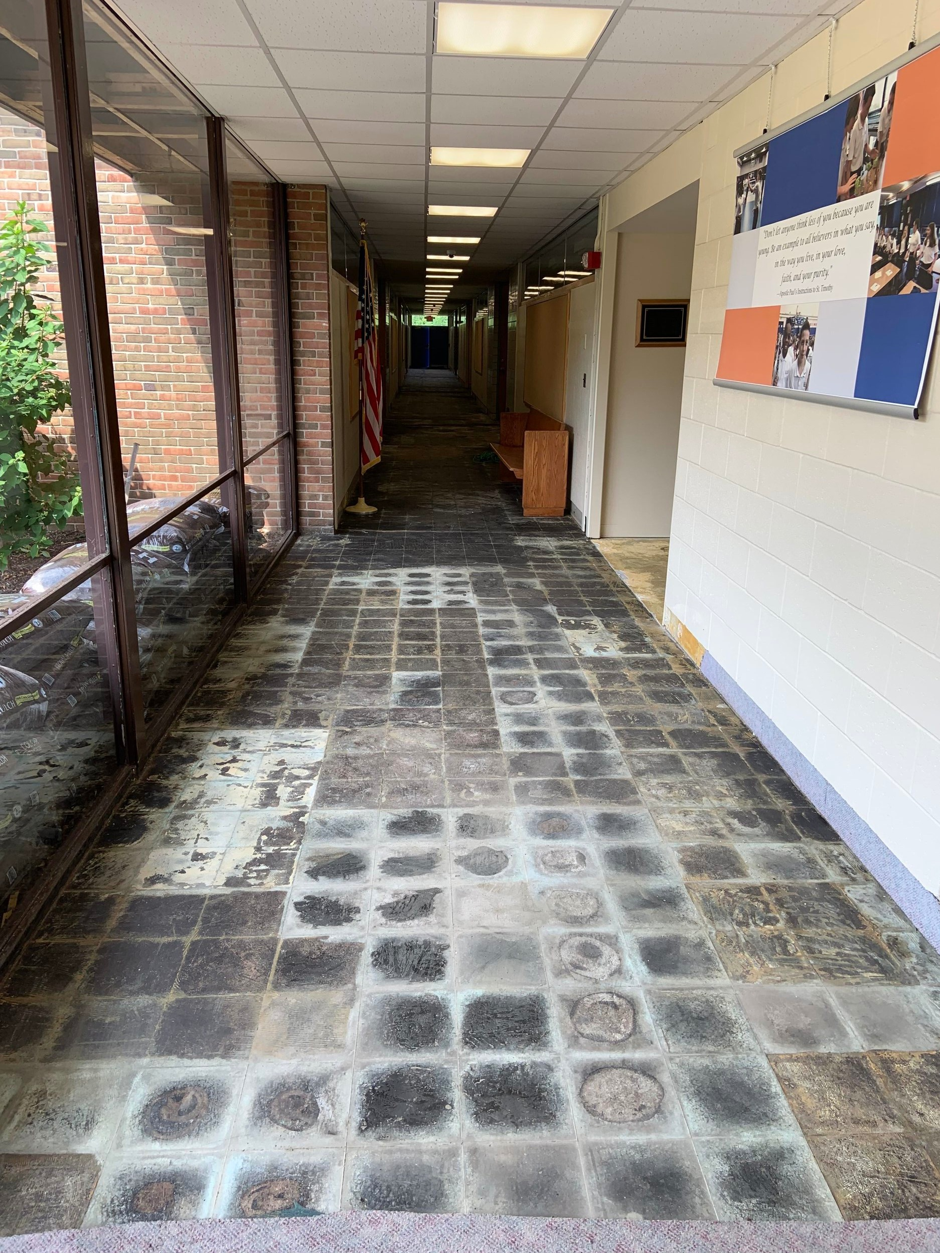 Beginning stages of the installation of new carpets throughout the school.