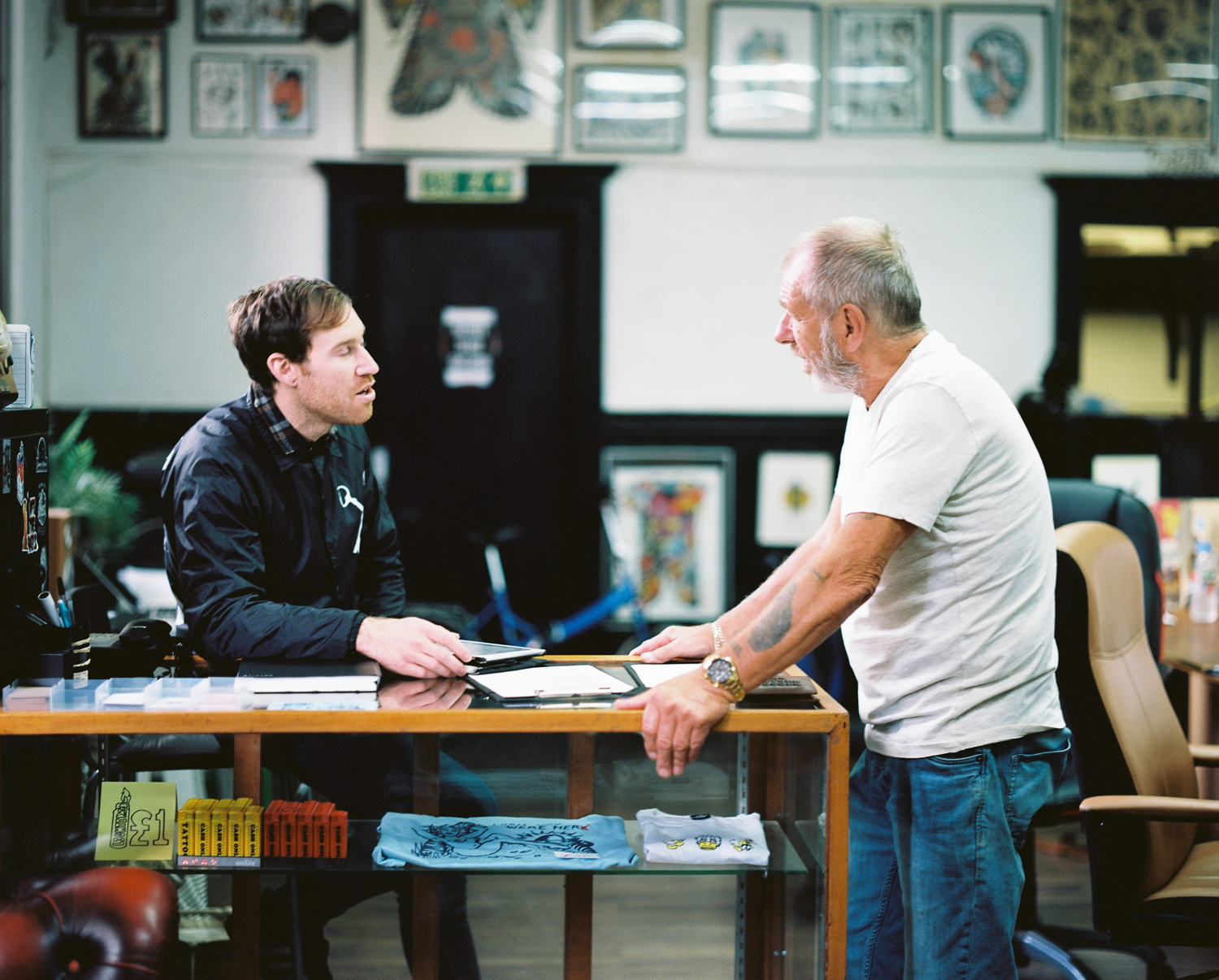 Dad & Baker discussing tattoo options