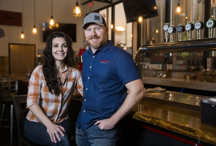 Veronica and Craig posing in the Tap Room at Lakewood Brewing Company. Photo by Ashley Landis.