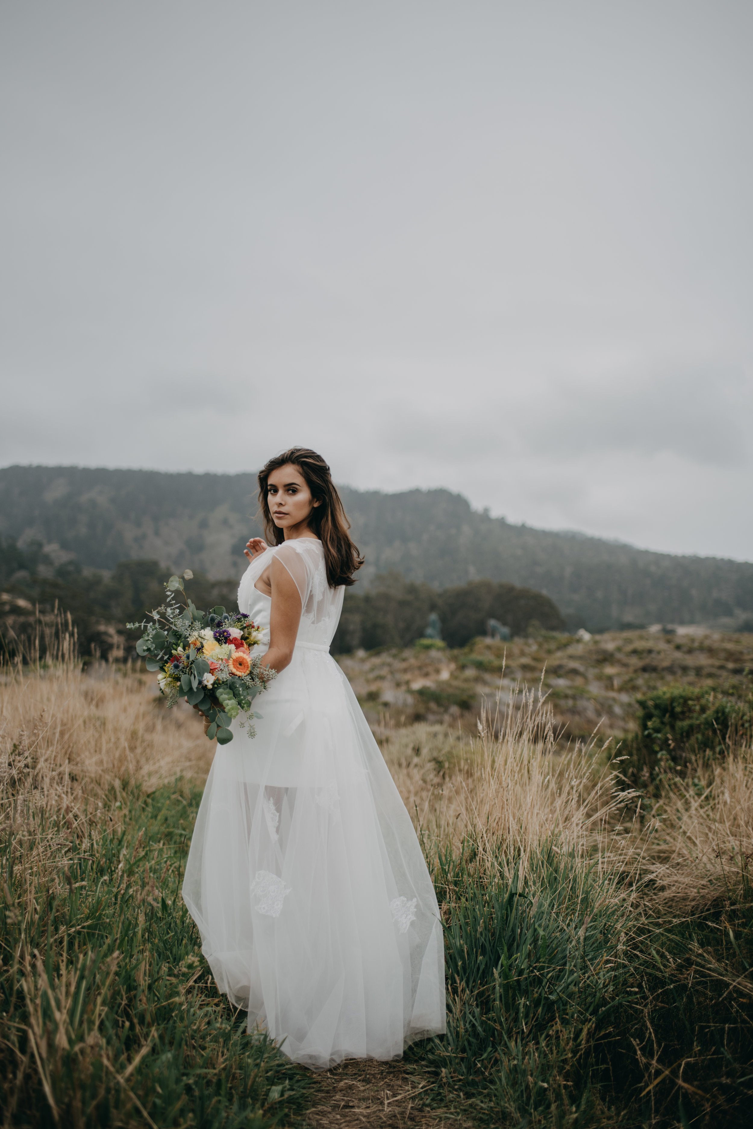 short wedding dress with long tulle layer over