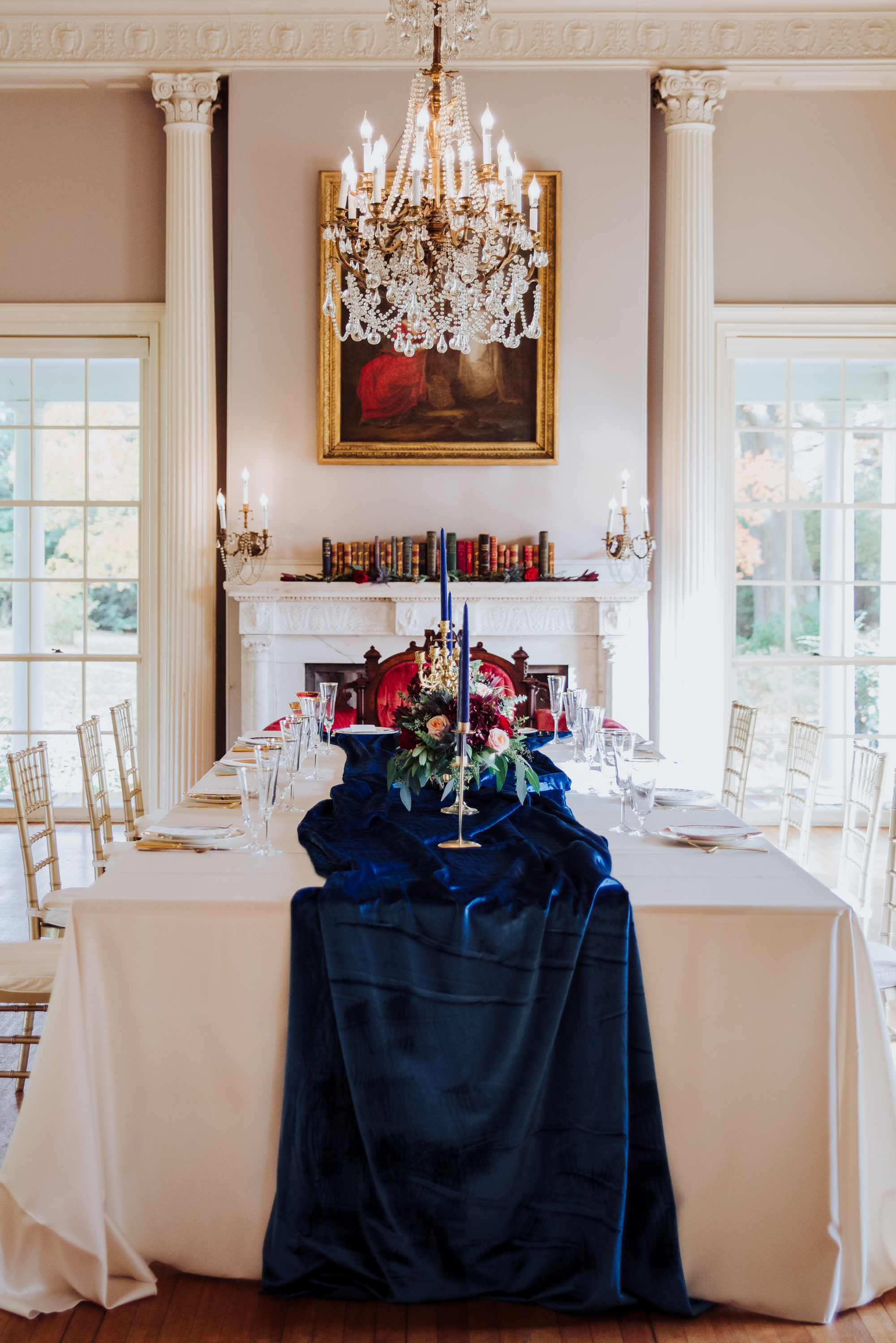 graceful regal wedding venue interior chandelier dining room ball room royal blue accent