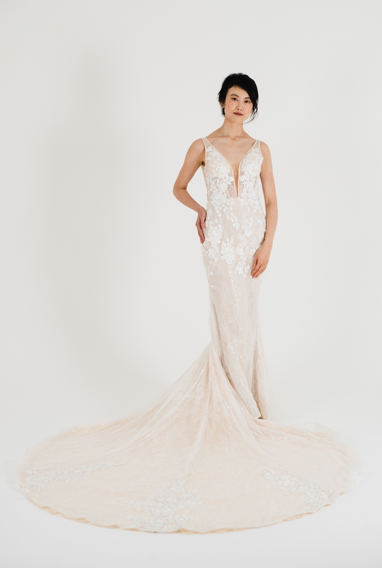 peach toned graceful wedding dress mermaid fit and court train