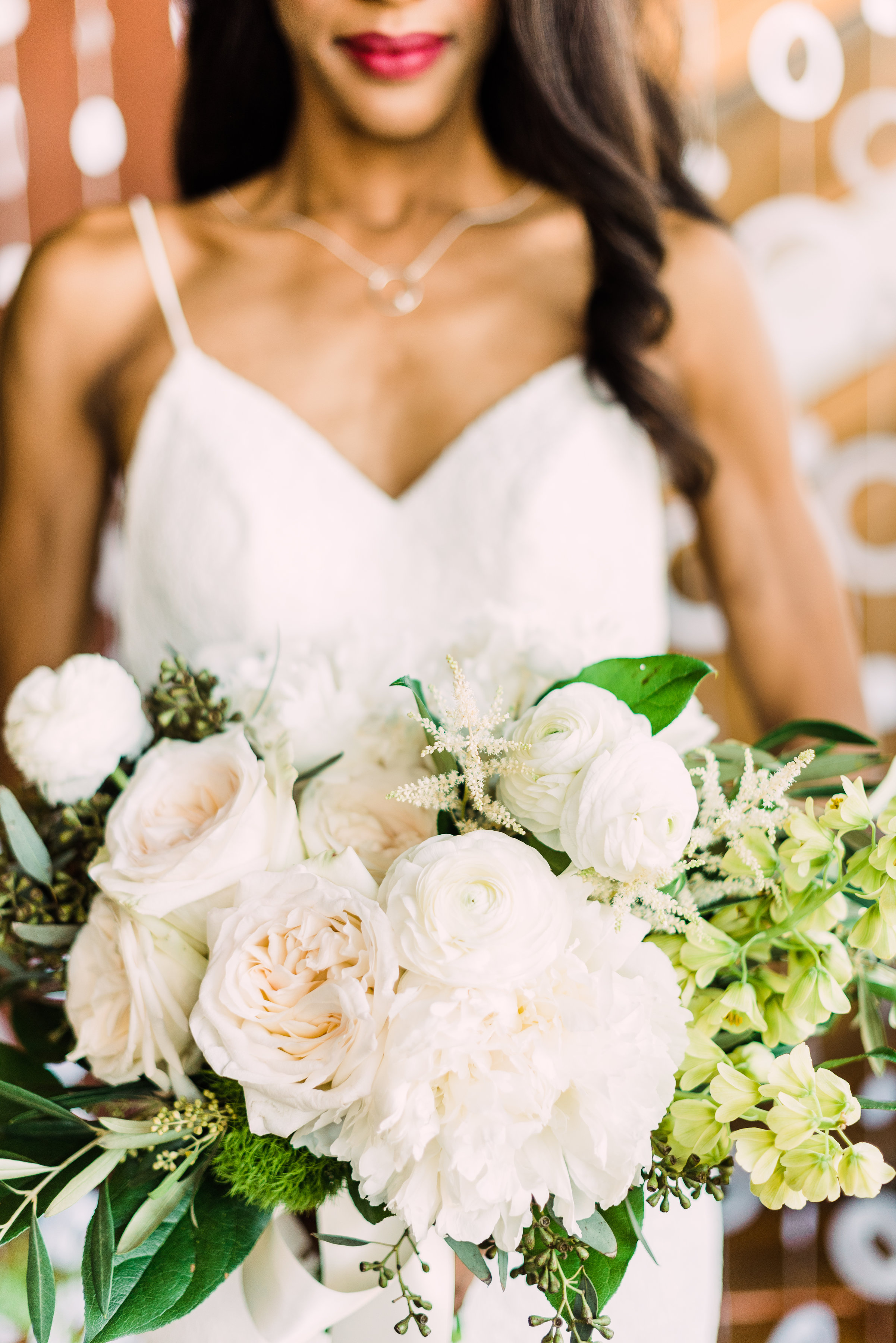 white floral bouquet white simple wedding dress for modern bride