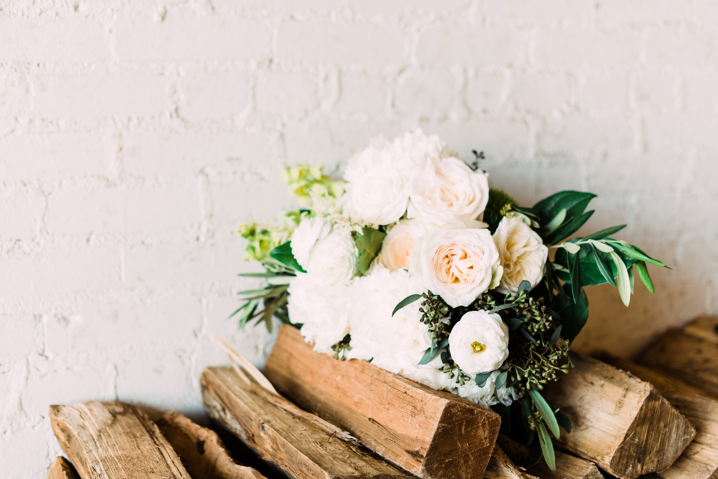 rustic wedding venue beautiful white roses for simple modern bouquet