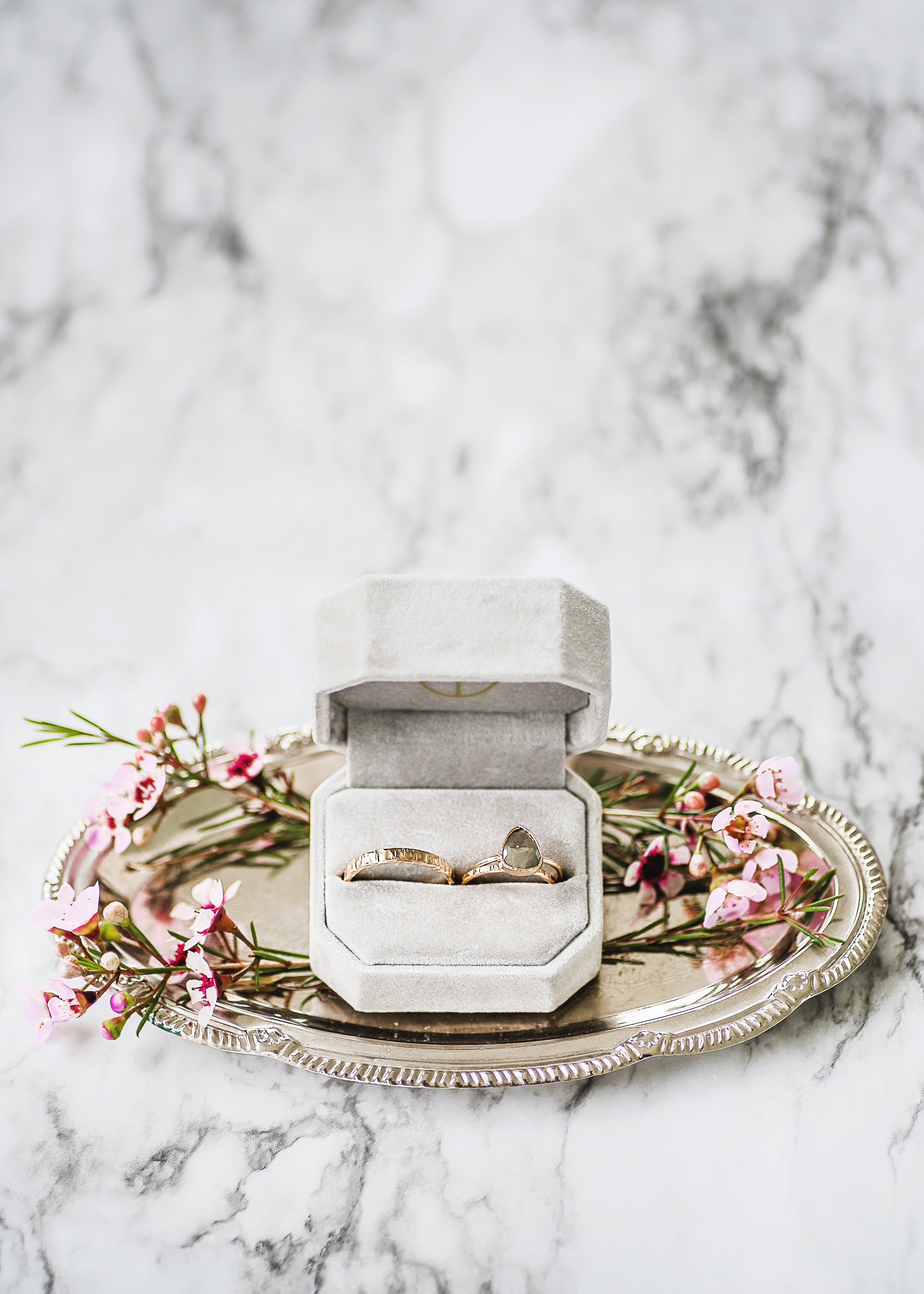 simple modern wedding ring and band in case