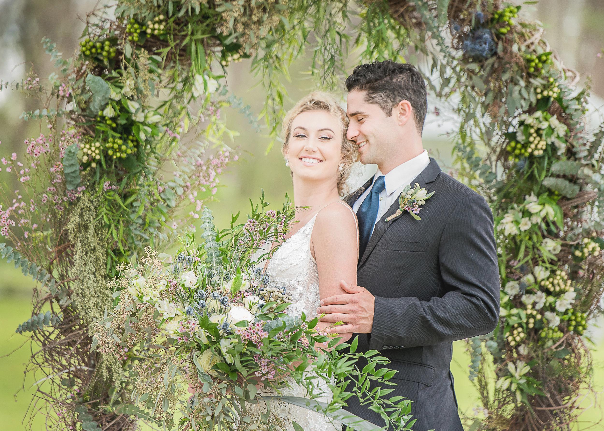 flower wreath outdoor wedding photoshoot floral lace simple modern wedding gown under $1000