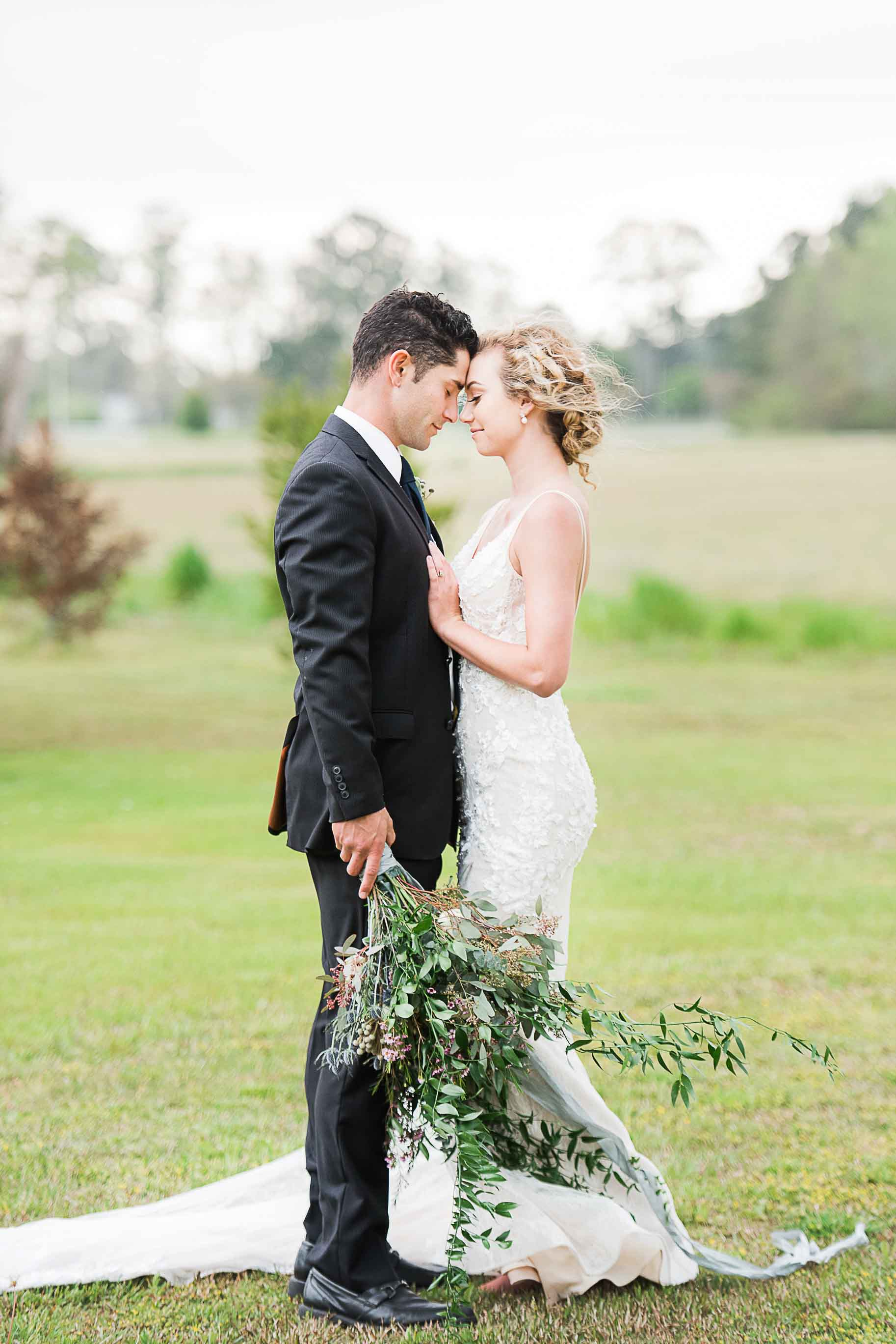 custom made wedding gown under $1000 mermaid fit with court train plunging v neck detail