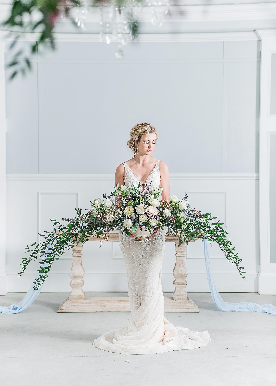 court train mermaid fit wedding gown simple modern wedding dress under $1000 for the modern bride