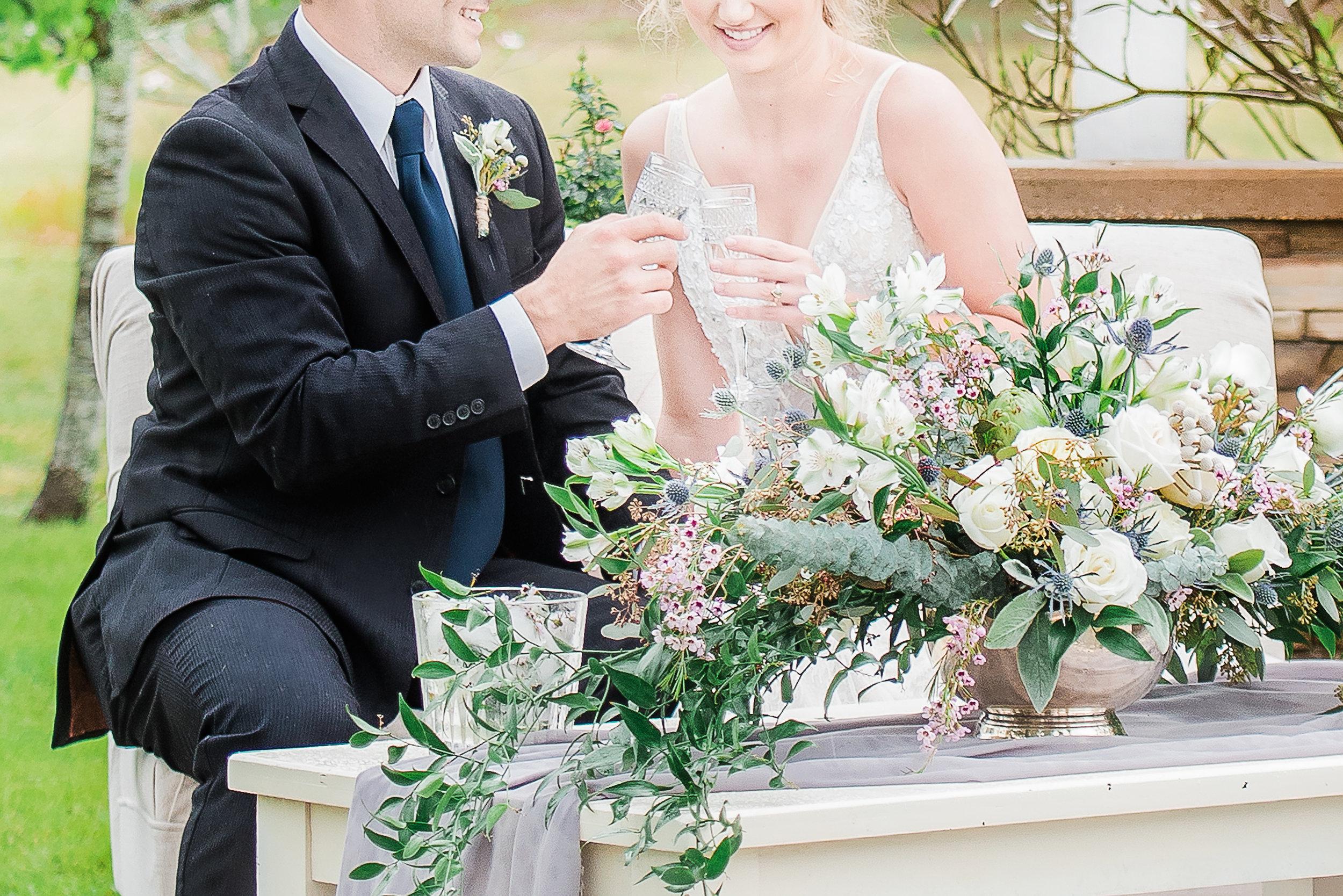 outdoor wedding photography cheers bride and groom