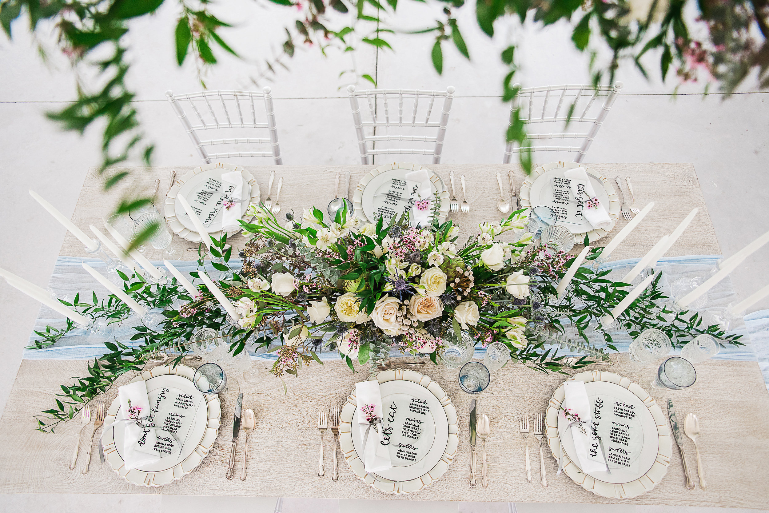 birds eye view wedding venue tablesetting photography floral centerpiece