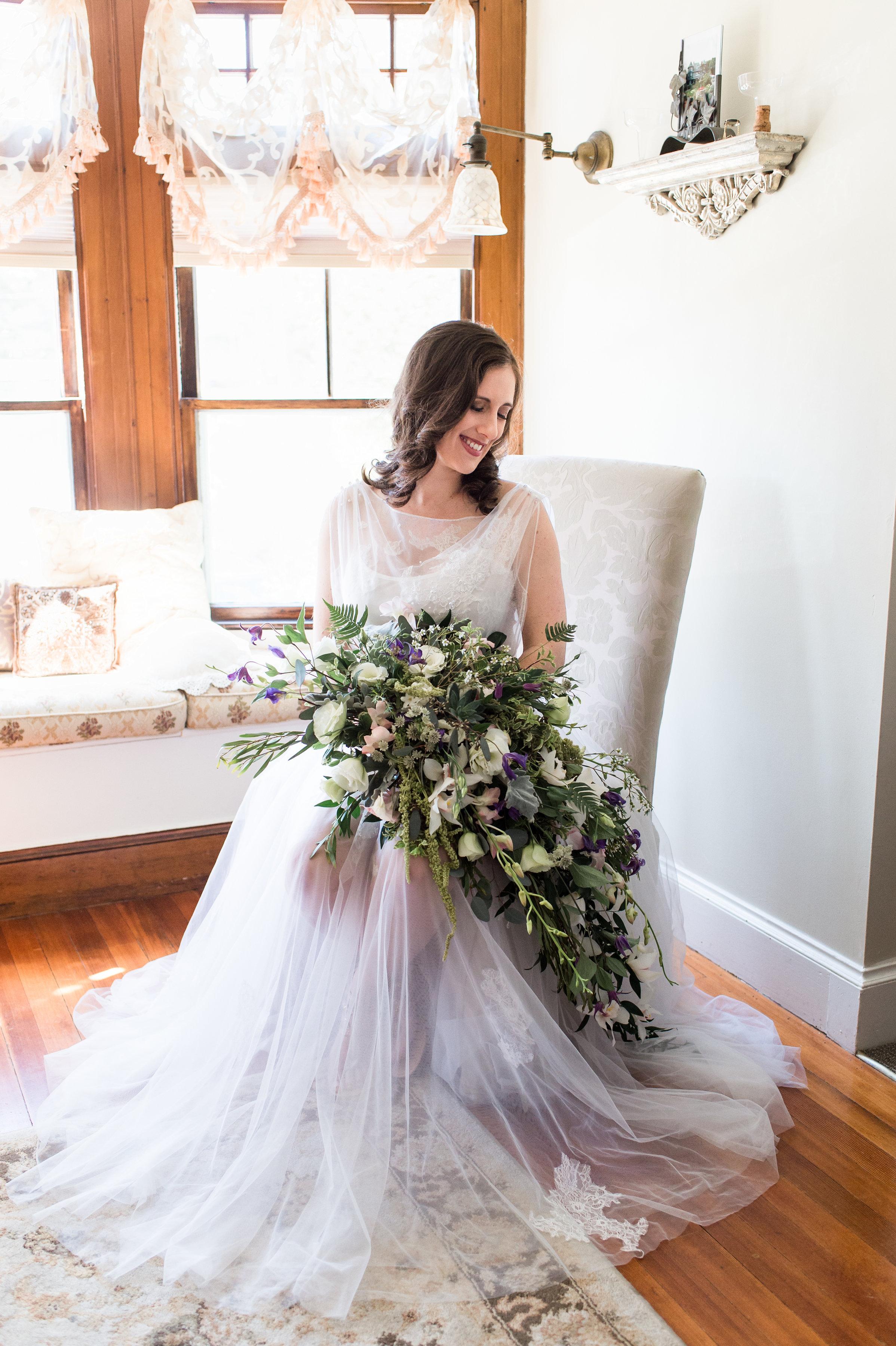 coastal wedding photoshoot unique two piece wedding dress with cascade purple and white bouquet