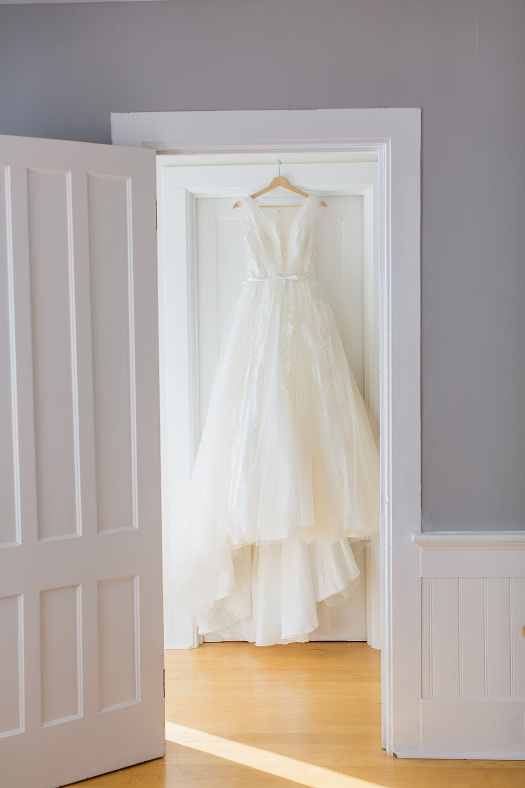 simple playful wedding dress hanging photo