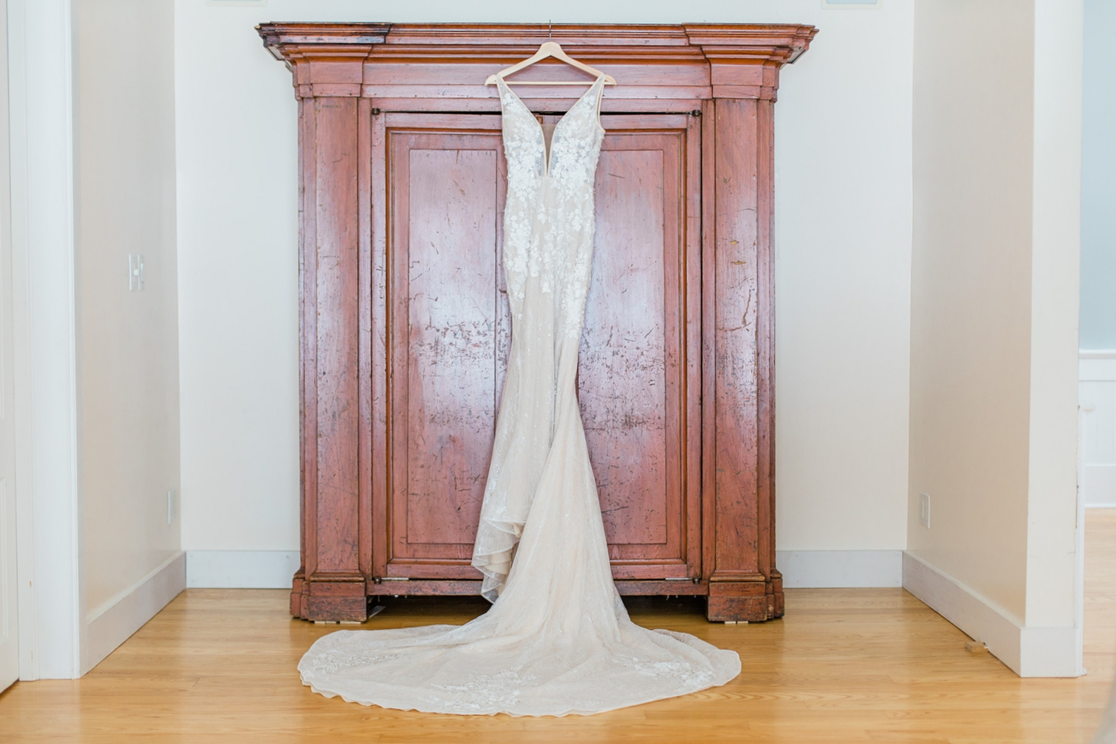 court train peach toned wedding dress hanging photo