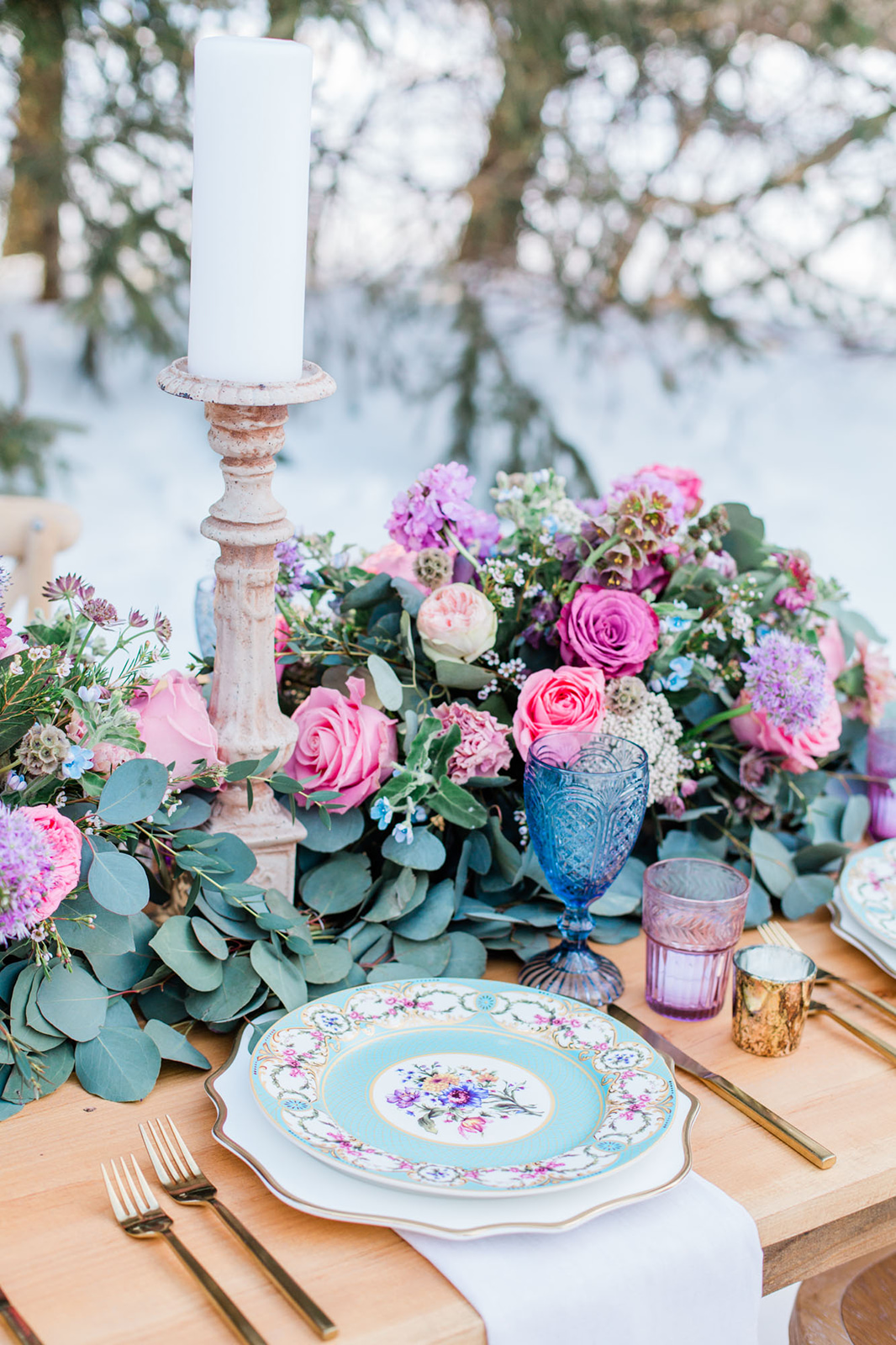 cool tone winter flower centerpiece outdoor table setting for wedding