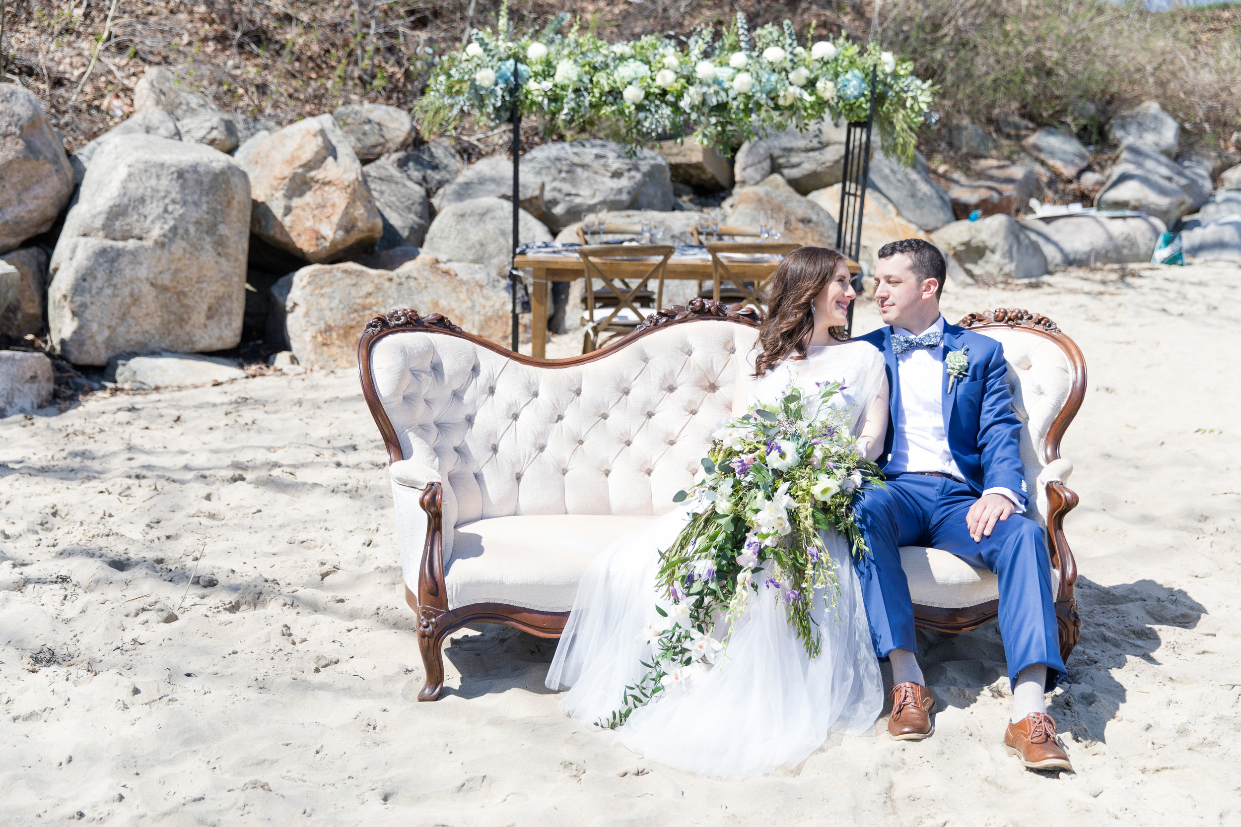 summer beach side wedding  floral decorations big bouquet blue tux