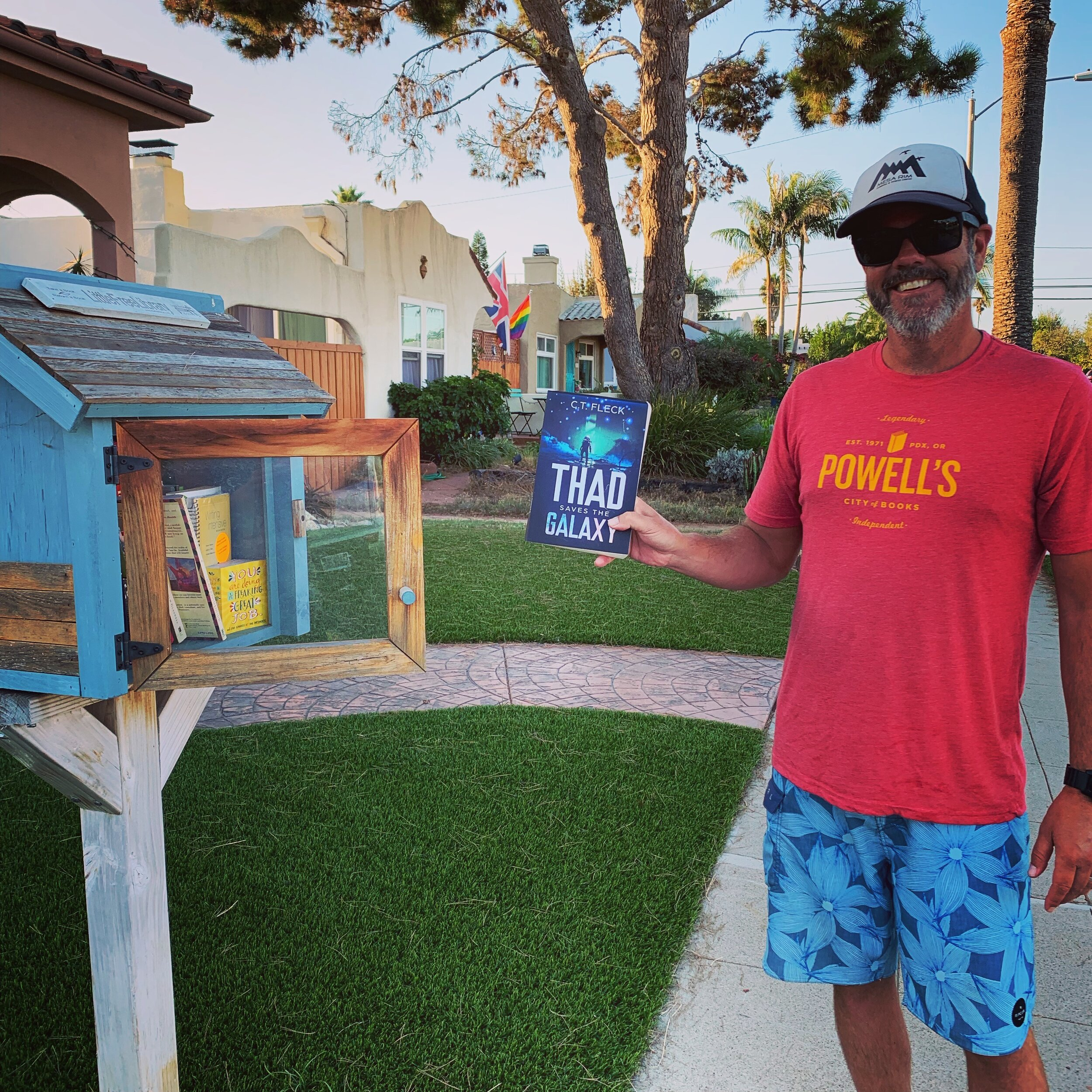 Thad Saves the Galaxy going in to a free little library.