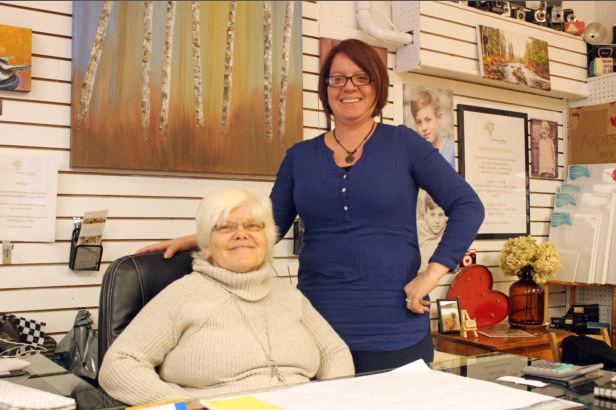 From left, Karen Keller and her photography teacher, Country Camera's Lesley McCormack, celebrate Keller's success as an up-and-coming area photographer. Her work is currently featured at Hastings Highlands Public Library. / SARAH SOBANSKI Staff