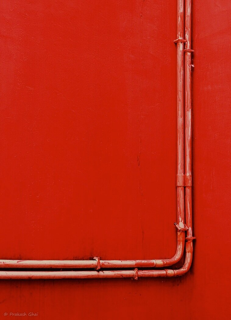 minimalism-two-red-pipes-red-wall-love-story-minimalist-photography-blog.jpg