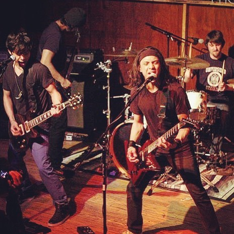 #TBT playing #WickedWolf 🐺 New Haven (formerly #Playwright, currently #Vanity) 🤘🏽 . Missin those long locks 💇🏻‍♂️ . . . . . Those forearms doe 💪🏽 . . #ctmusic #NewHaven #newmusic #poppunk #longhair #music #bands #musician #rockandroll #guitar #allblack #allblackeverything