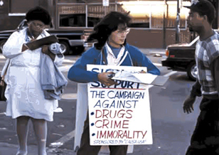 A woman collects signatures for CAUSA USA