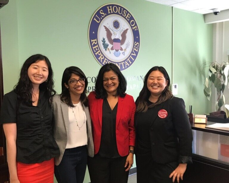 Seattle chapter leaders meet with Representative Jayapal. They gave her a NAPAWF pin!