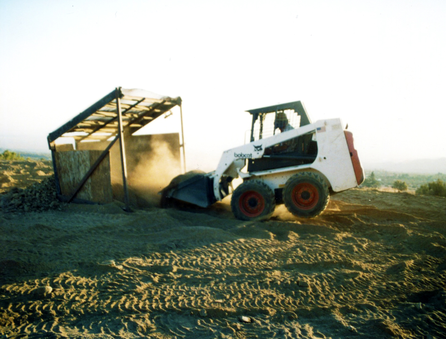 Bobcat wheelie while screening the dirt.