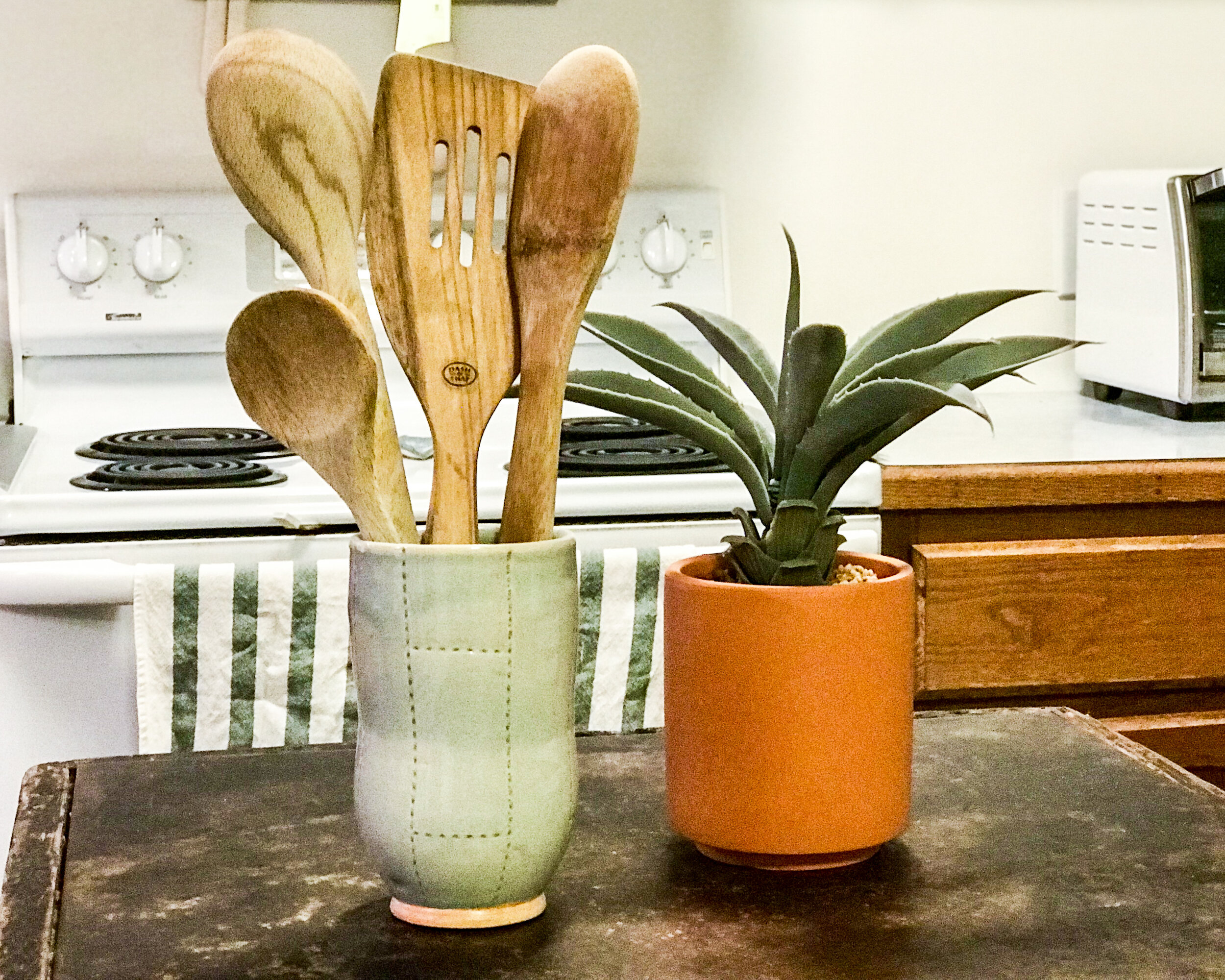 wooden vase with spoons