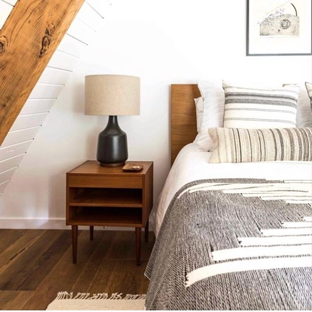 downstairs bedroom 🖤 sometimes you just need a cocoon.. the cabin is filled with soaring ceilings and light filled spaces- I wanted the downstairs bedroom to be a grounding hideaway - blackout curtains, earthy, darker accessories and lots of cozy blankets make this the perfect space to rest and recharge🖤 ..📷@katalves, design/remodel @blythedesignco , art @solange_roberdeau + @shmidosan