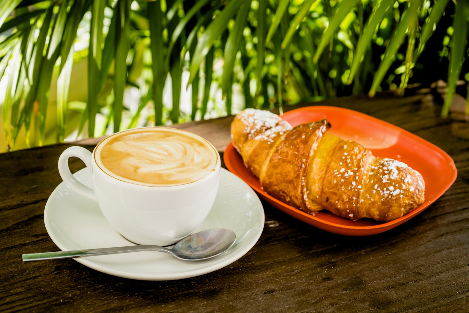 croissants and baked goods, cappuccinos, lattes, and espresso