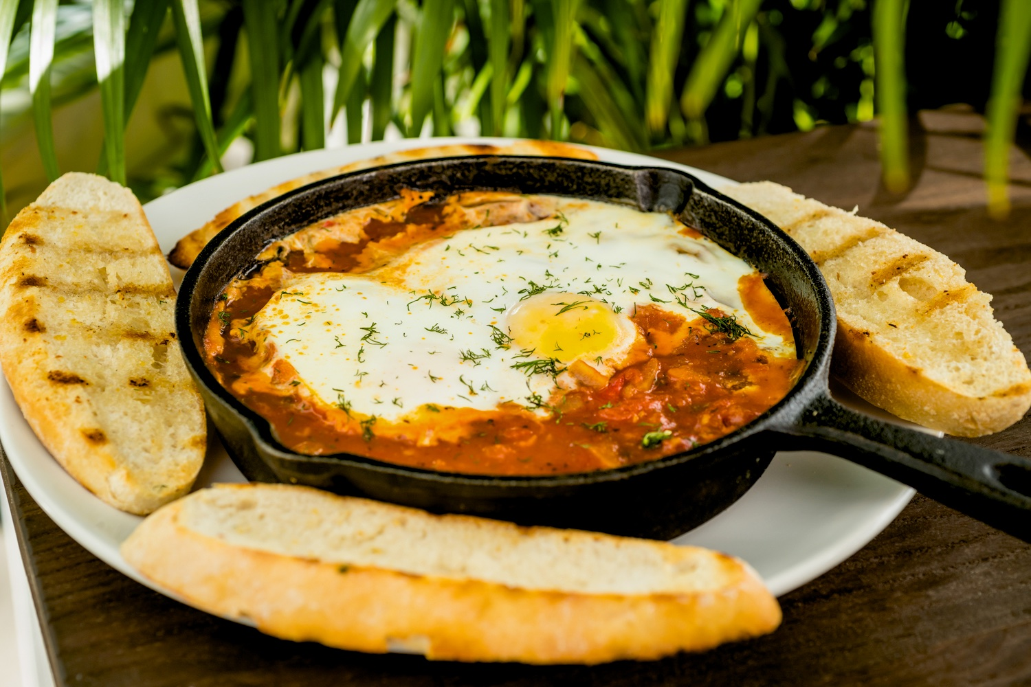 Shakshuka with warm garlic grilled ciabatta, gluten free option available
