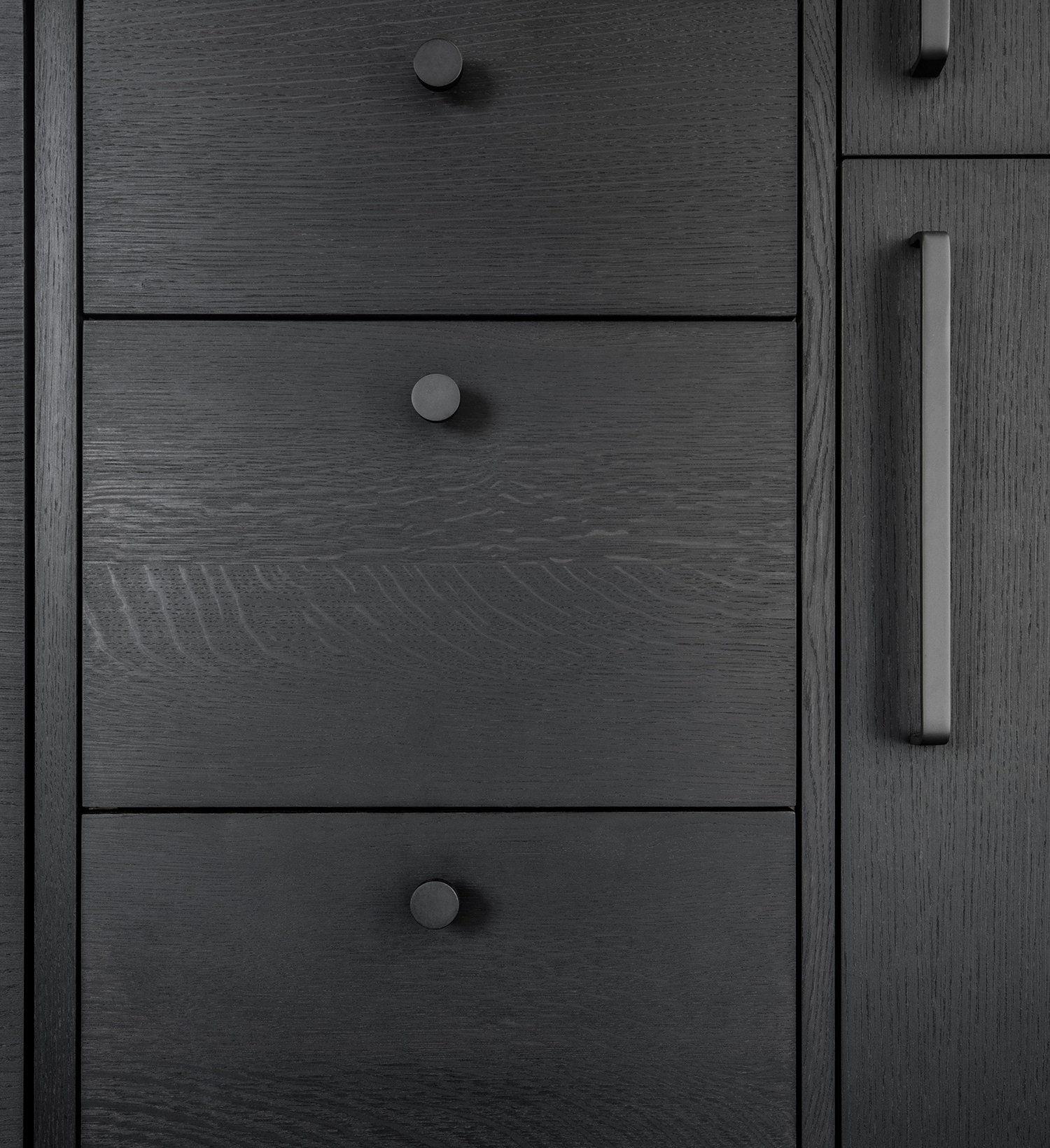 detail of custom kitchen cabinetry in ebonized oak