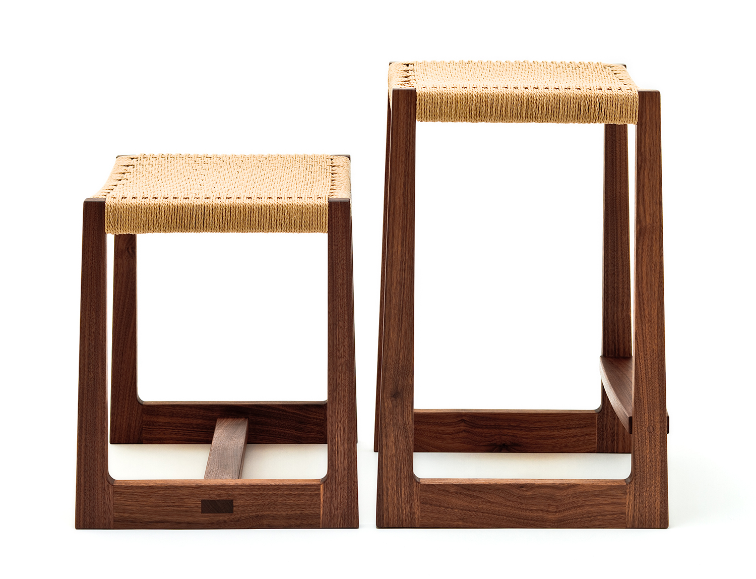 Low and tall Matteawan stools in walnut and natural Danish cord